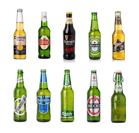 guinness beer: CHISINAU, MOLDOVA - January 04, 2016: Photo of a  bottles of Corona Extra, Stela artoua, guinness, Heineken, Millir, Tuborg, bavaria, Carlsberd, Beck, Grolcsh  Beer