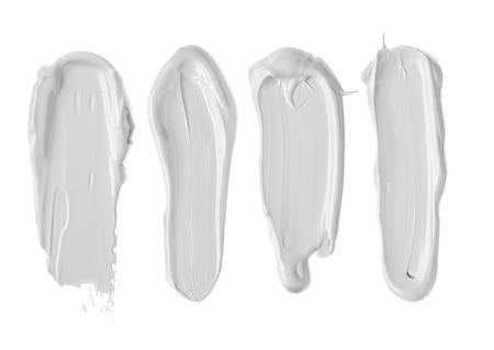 moisturiser: White Face Moisturiser, Cream Splodges isolated on white background