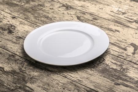 Assiette vide sur le fond de la table en bois Banque d'images