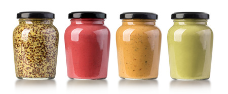 set of Mustard Sauce , Whole Grain Mustard  and barbecue sauces in glass bottles on white background