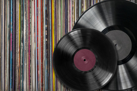 cf: Vinyl records with cf a collection of albums background Stock Photo