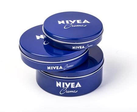 incorporated: Chisinau, Moldova - August 30, 2016: Nivea Cream three jars on white background. Nivea brand owned by the German company Beiersdorf AG.