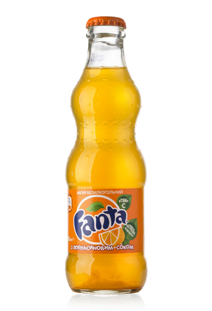 fruit drinks: Chisinau, Moldova - August 26, 2016: Glass Bottle of Fanta Orange. Fanta is a global brand of fruit flavored carbonated soft drinks created by The Coca-Cola Company. Editorial