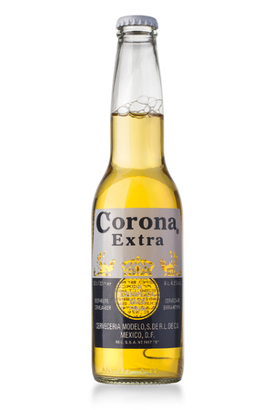 ounce: CHISINAU, MOLDOVA - August 26, 2016: Photo of a bottle of Corona Extra Beer. Corona, produced by Grupo Modelo with Anheuser Busch InBev, is the most popular imported beer in the US. Editorial