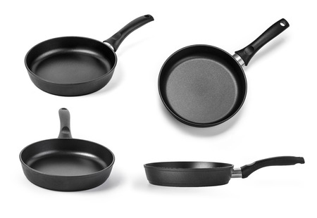 adherent: black frying pan. Isolated on a white background