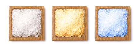 l natural: Healthy sra salt in wooden bowsl closeup isolated on white Stock Photo