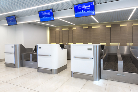 airport check in counter: Chisinau, Moldova - September 27, 2016:   passenger check-in area in  a  international airport in Chisinau, Moldova