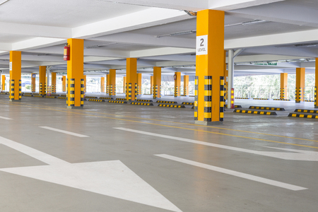 empty Parking garage underground, industrial interior Stock Photo