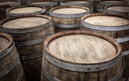 wineries: Barrels in the wine cellar background for your design
