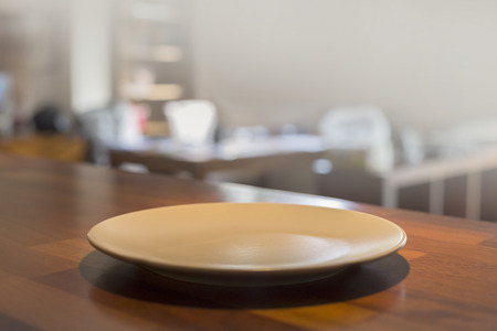 able: Empty Plate on the kitchen  wooden table  background