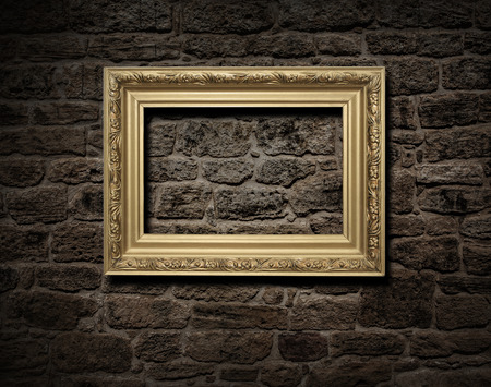 compile: Empty golden frame on a brick wall background Stock Photo