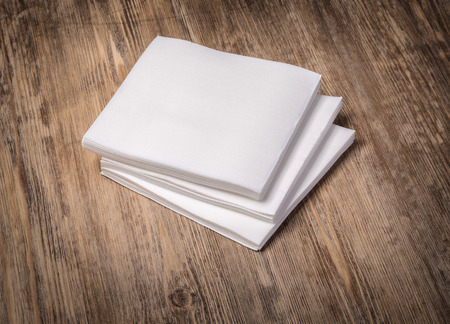 white paper napkin on old wooden table Stock Photo