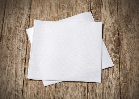 white towels: white paper napkin on old wooden table Stock Photo