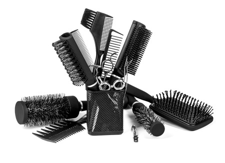 scissors comb: Hairdressing tools on white background