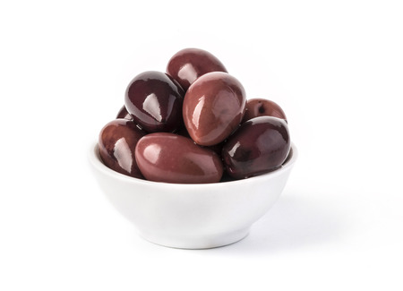 morsel: Pickled pitted black olives in a bowl isolated on a white background Stock Photo