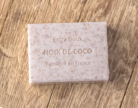 noix: Chisinau, Moldova -November 10, 2016: Extra doux noix de coco soap bar  over wooden background Editorial