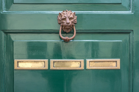 hinged: green door knocker and letterbox concept
