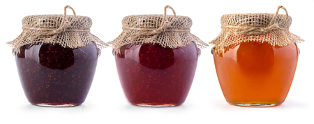 Three jar of jam and honey on white background