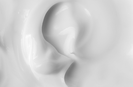 Cosmetics. Cream white background texture.