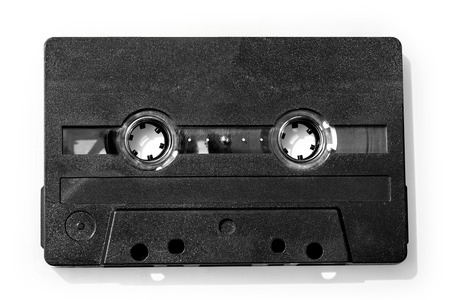 Old compact audio cassette (tape), macro shot on white background