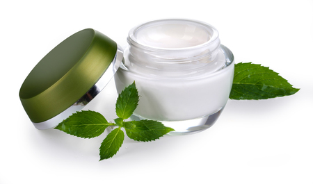 jars: Cosmetic bottle container with green leaves, isolated on white background. with clipping path