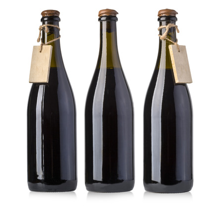 objects drink: vintage wine bottles with blank tag isolated on white  Stock Photo