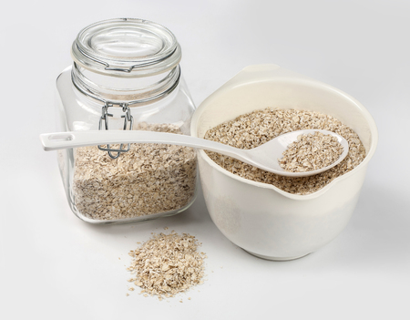 Dry rolled oatmeal in glass jar.