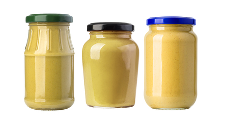 A yellow mustard bottle against a white background Stock Photo