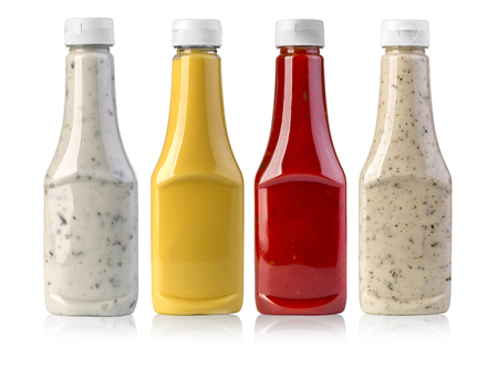 barbecue sauces in glass bottles on white background Stock Photo