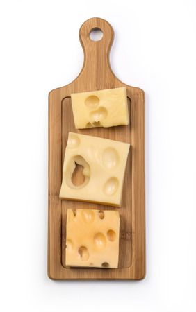 various types of cheese on wooden board isolated with clipping path