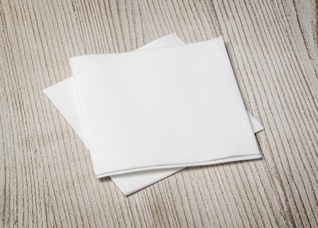 decoracion mesas: white paper napkin on old wooden table Foto de archivo