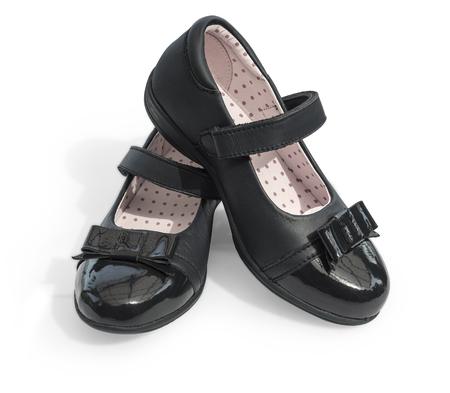 Black shine leather girl shoes isolated on white Reklamní fotografie - 87172969
