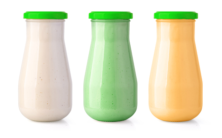Bottle with tasty  sauce on white background
