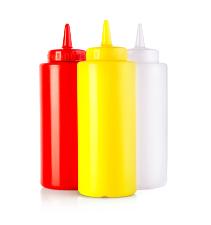 three plastic sauce bottles  isolated on a white background