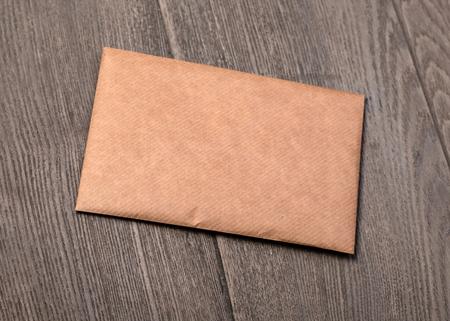 Old brown Envelope on a wooden background