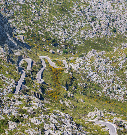 Cars driving popular among tourists beautiful winding mountain serpentine Coll dels Reis, Mallorca, Spain