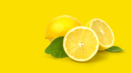 lemon isolated on yellow background with clipping path Фото со стока