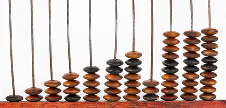 Close up of wooden abacus or counting frame with brown colored beats in it.Isolated on white. Stock Photo