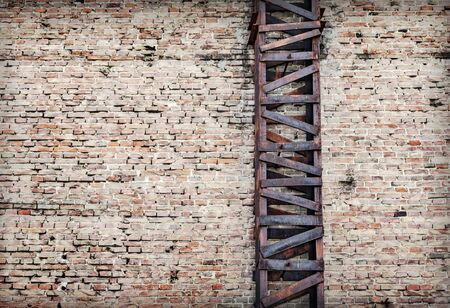 Rusty and old metal beams support system for brick wall - texture background