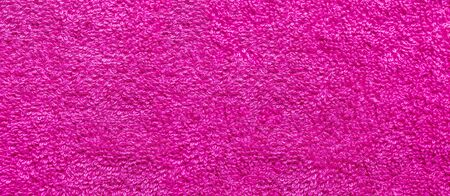 pink fabric and texture concept - close up of a towel terry cloth