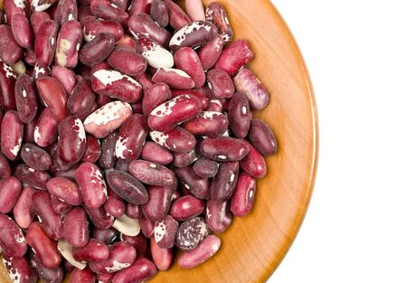 beans closeup on wooden plate on white background with clipping path