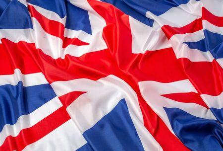 Primo piano della bandiera britannica arruffata - fondo del tessuto
