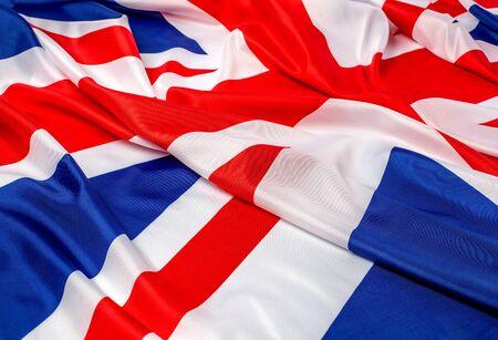 Primer plano de la bandera británica con volantes - Fondo de tela Foto de archivo