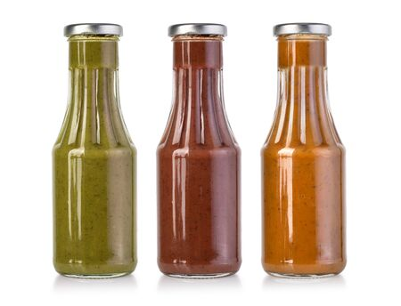 barbecue sauces in glass bottles with clipping path Reklamní fotografie