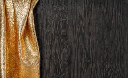 wooden dark texture with gold textil, with copy space Banque d'images