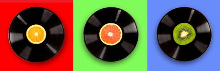 vinyl record on a bright red background. The concept of fresh music party