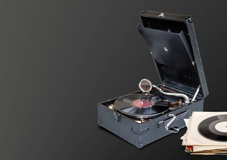 gramophone playing a vinyl record on brown background