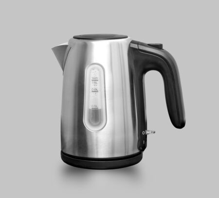 electric kettle on a grey background Archivio Fotografico