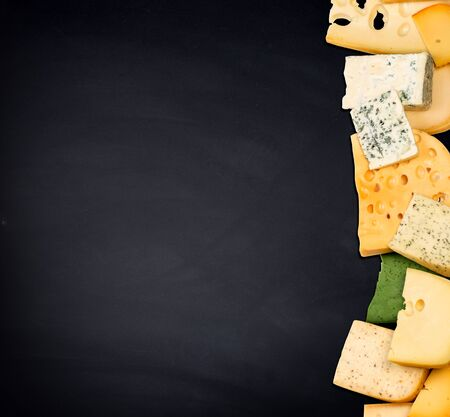 Different kinds of cheese on grey background, copy space 免版税图像