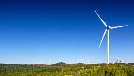concept idea eco power energy. wind turbine on blue sky
